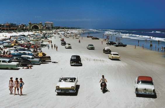 """""""Cars, motorbikes, and bathers share one strip of sand in 1957, Daytona Beach, Florida.""""UNITED STATE... - Nostalgic Journeys - Destinations and Adventures from the Golden Age of Travel, published by teNeues, www.teneues.com, Traffic congestion on Daytona Beach, Florida, 1957, Photo © J. Baylor Roberts/National Geographic/Getty Images."""