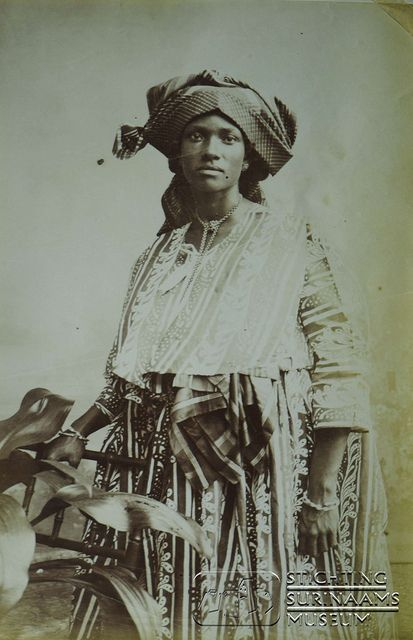 """Vintage ca 1903, African Surinamese woman in """"koto"""" outfit, so she is called a """"kotomisi; a miss/mrs in a koto"""""""