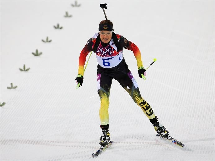 DAY 3:  Evi Sachenbacher-Stehle of Germany approaches the finish line in the Women's Biathlon 7.5 km Sprint