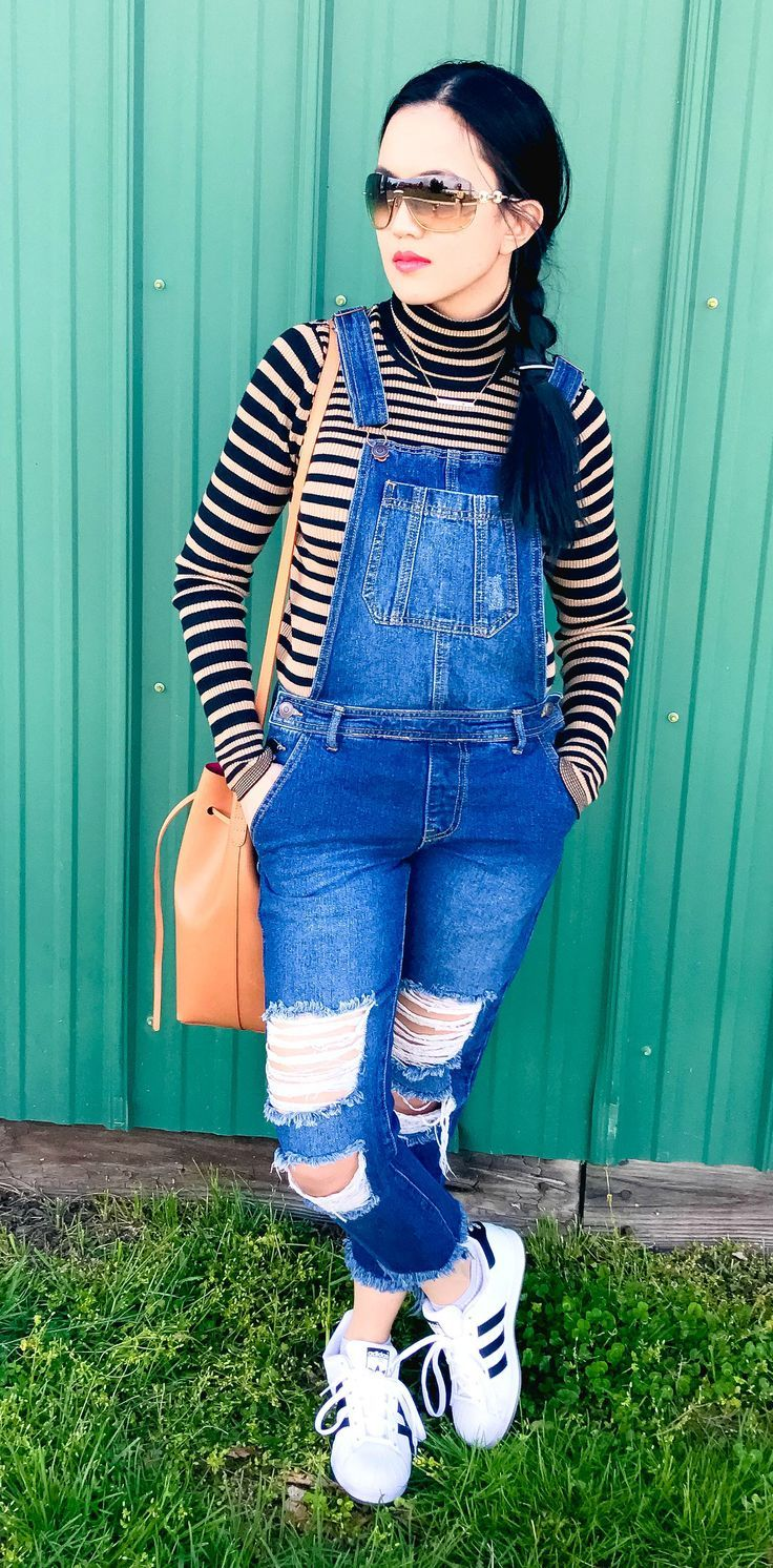 woman wearing striped Express turtleneck top, distressed Forever 21 denim overalls, white Adidas sneakers, Mansur Gavriel bucket bag in Cammello Dolly, Gucci sunglasses, and Tickle Bug Jewelry Birthstone Bar necklace - outfit ideas, style fashion, and style inspiration for spring fashion, spring outfits, summer outfits, and summer fashion