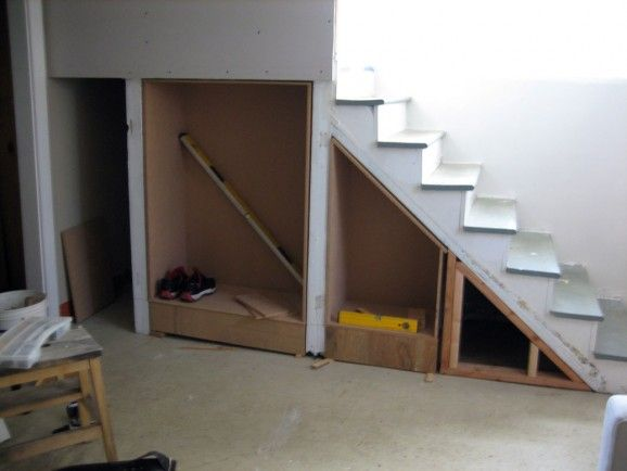 Building shelves under stairs - build boxes to insert between studs (be sure to make not too deep so there's still storage behind for taller items/luggage)