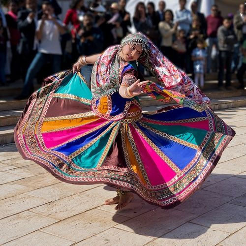 Love the colors in the skirt and outfit - colourful indian folk dance...