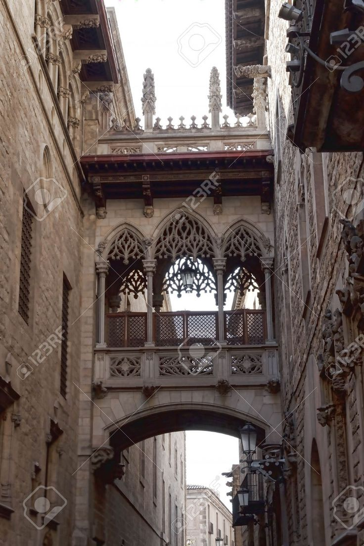 Arch-balcony Between The Houses In The Gothic Quarter Of Barcelona Stock Photo, Picture And Royalty Free Image. Image 38165823.