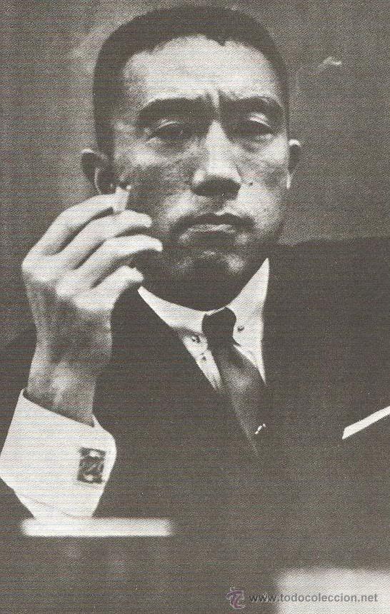 Yukio Mishima smoking and looking thoughtful