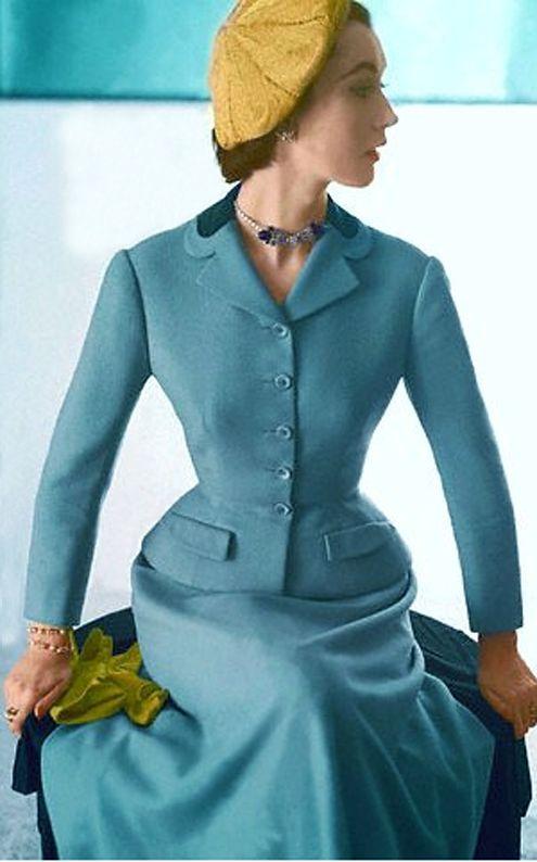 American model Dovima wearing a suit by Hattie Carnegie, 1952