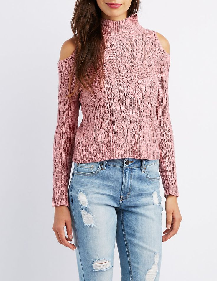 Online only! Chunky cable knit shapes a classic sweater, with cold shoulder cut-outs for a trendy update! A mock neck sits above the cozy long sleeves, with ribbed knit trim styling a soft finish.