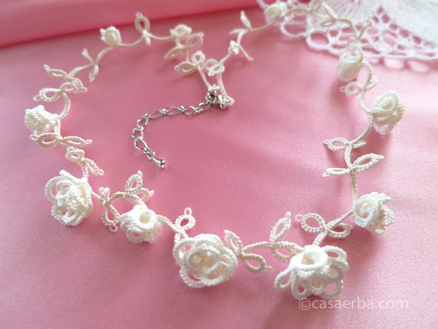 "No split rings. Worked in three sets/rows of connected stacked clovers. CasaERBA: Tatted Rose Necklace and Hiking Kakudayama ""Tatting Lace Accessories"" by Peikko Takako"