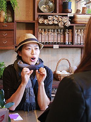 Vicky Ha talking to customer