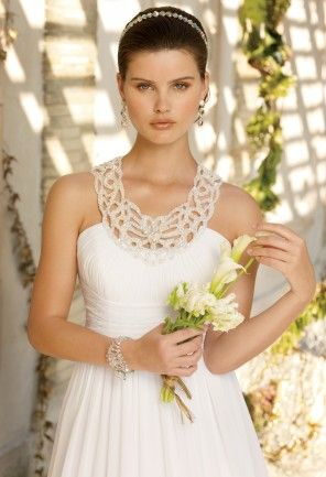 Chiffon Grecian style wedding dress with beaded cut out collar.