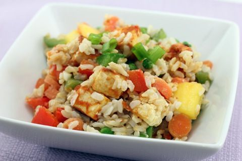 If I had this bowl of Mango Coconut Fried Rice in front of me right now, I'd tell you to load on the Sriracha. As in, pour a whole bottle on. Because, as Chels mentioned in her previous post (about our GLORIOUS weekend!), we're both feeling a little bit under the weather this week. OK, A LOT BIT. Truth be told, I haven't been in the kitchen in over a week. As a matter of fact, tonight was the first time I ate anything of any sustenance since Sunday afternoon. Which basically means anything…