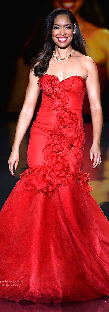 Gina Torres walks the runway wearing MARCHESA for the 2014 Red Dress Collection annual charity event benefiting The Heart Truth®