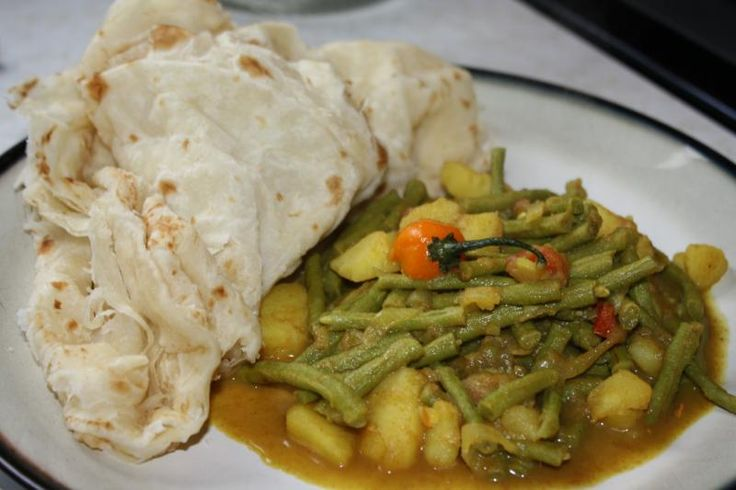 Curried bodi (a kind of string bean) with potato: a vegetarian delight.