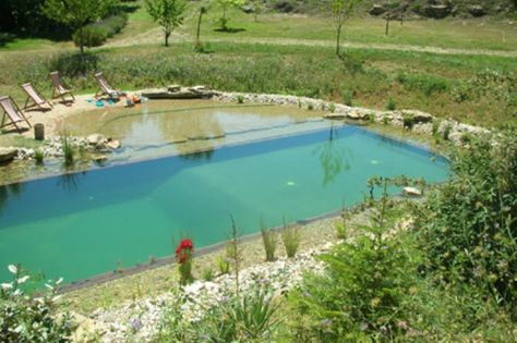 Natural swimming pool. Conversion with added beach. www.bionovanatura...