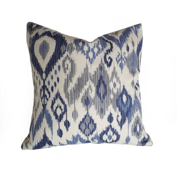 blue and white slight cream ikat pillows remind me of a coastal beach house