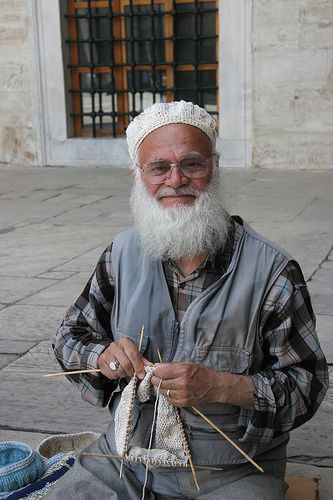 Gentleman knitting woolen caps at The Blue Mosque ( Sultanahmet Camii ) Istanbul, Turkey.