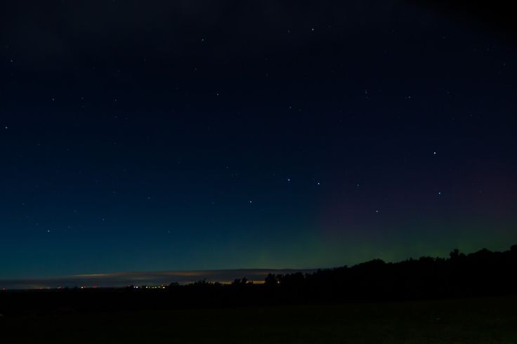 College senior Tyler Baldino sent in this amazing photo of an aurora and the stars of the Big Dipper as seen from Canton, New York, just outside of St. Lawrence University, about 20 miles south of the St. Lawrence River. The image was taken on Sept. 12, 2014, as the first of two solar storms was reaching Earth.<br />