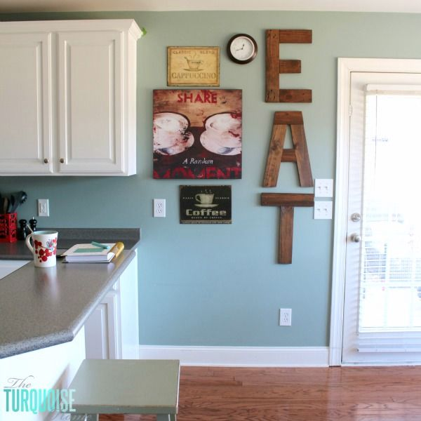 DIY Painted Kitchen Cabinets with Benjamin Moore Simply White and EAT sign from pallets | Details at TheTurquoiseHome.com