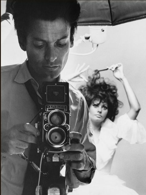 Avedon and Sophia Loren by Richard Avedon. This is an interesting image as he has captured both himself and the model, but the model appears to be completely unaware of the camera, as her facial expression appears to be quite vacant and neutral, as though she is lost in her own world.