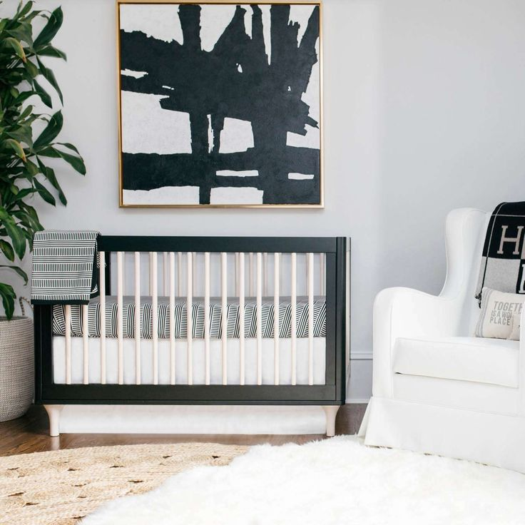 Black and white is hardly boring, yet it's a no-fail palette that can easily become a bold look for a modern nursery.