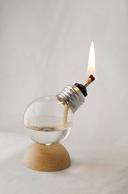 Turn an old burnt-out bulb as a whole other kind of light: a mini oil lamp!