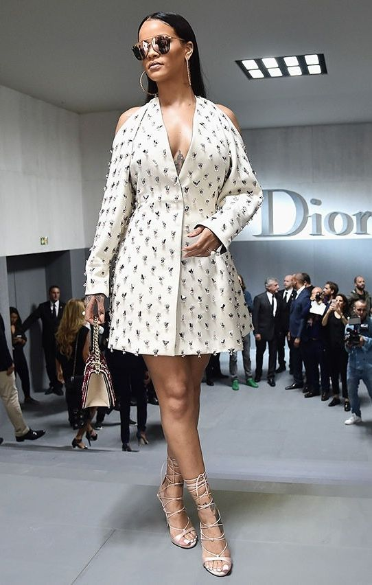 Rihanna gave her embellished Dior dress a touch of street style with extra large hoops and mirrored shades.