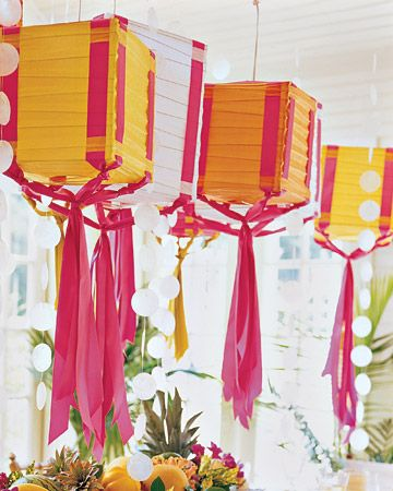 Ribbon Party Lanterns  Use a paper box lantern and satin and grosgrain ribbon to make colorful party decorations that hang from the ceiling.