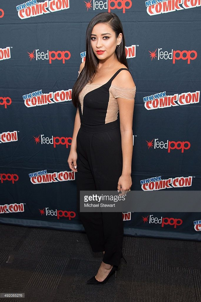 Actress Shay Mitchell poses in the press room for the 'Pretty Little Liars' panel during New York Comic-Con Day 2 at The Jacob K. Javits Convention Center on October 9, 2015 in New York City.