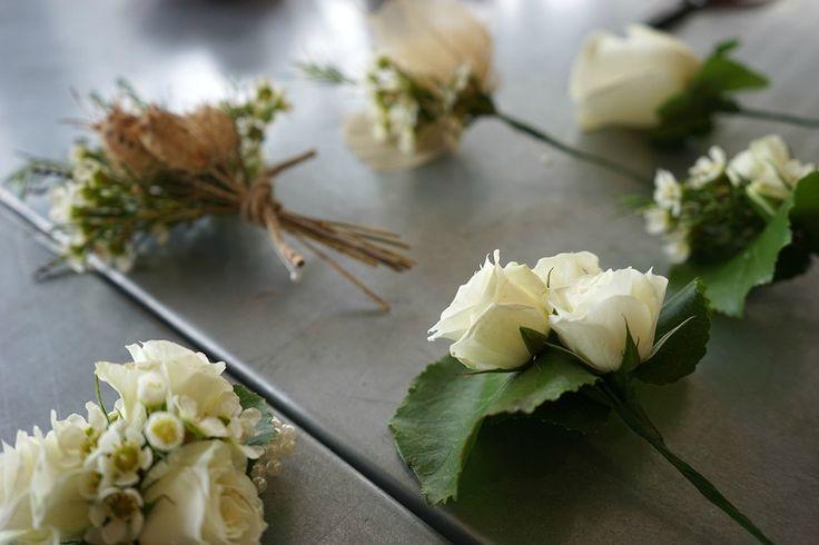 Beautiful classic boutonnieres!  #boutonnieres #classic #WhiteWedding #russianriverflowerschool #White Roses #wedding #winterwedding