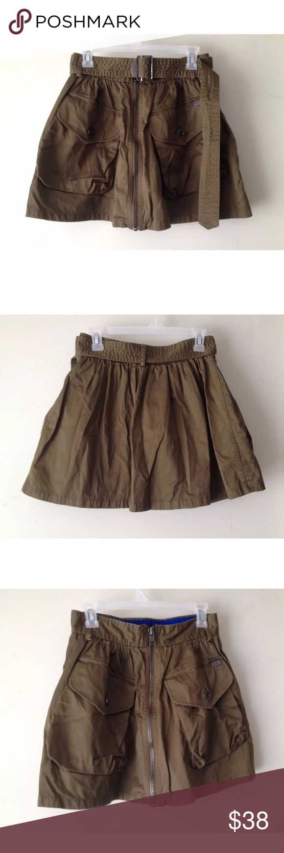 Diesel Olive 'O-Boden' Cargo Skirt, 29 Condition: regular wear and tear, no rips or stains, good condition Color: Olive Green (color doesn't show up so well in photos) Size: 29  Lightweight A-line mini skirt sports a military-inspired look. Belt-loops throughout waist with detachable pull belt. Gathering at waistline. Large cargo pockets at front with button-flaps. Full zip-front closure.  Waist ~ 28 inches Length ~ 16 inches Diesel Skirts Mini