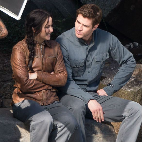 Another candid shot of Jennifer Lawrence and Liam Hemsworth filming The Hunger Games: Mockingjay
