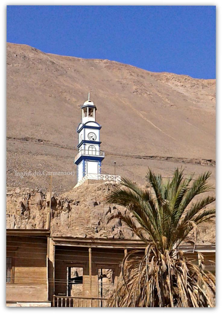 Torre del Reloj en Pisagua. Construída en 1887. Bajo ella se depositaron osamentas pertenecientes a los héroes del Desembarco de  Pisagua  en 1879.