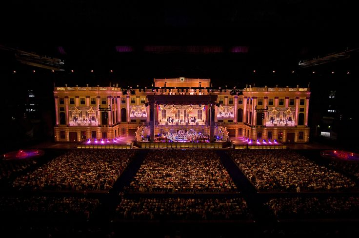 """André Rieu the King of Waltz A Dutch violinist, conductor and showman, André Rieu has sold more than 30 million albums worldwide. Crowned the """"King of Waltz"""" by the media, Rieu believes that everyone can enjoy classical music. Following in the footsteps of Johann Strauss himself, he encourages his audiences to get out of their seats and waltz in the aisles. Together with his 50-pieces Johann Strauss Orchestra, he tours on five continents. Every year, more than 700,00 fans attend an André…"""