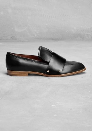 This pointed-toe loafer is made from smooth leather and has a rich, decorative design. - A wide strap detail across the vamp- The tongue of the shoe has a folded and flared design - A cushioned leather insole and a leather outsole with rubber beneath the heel- A stacked leather heel- Heel height: 1.5 cm