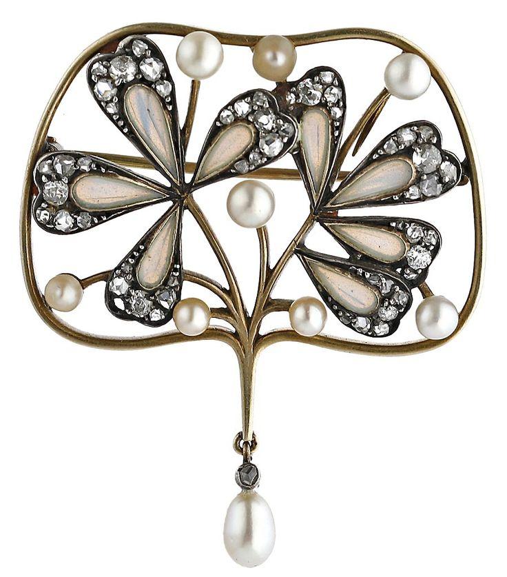 An Art Nouveau gold, silver, plique-à-jour enamel, diamond and pearl brooch.