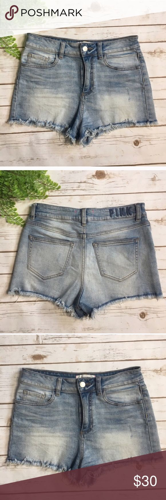 VS PINK Distressed Denim Shorts ☀️ Distressed denim shorts by Victoria's Secret Pink. Shorts are size 4 and fabric content is 98% cotton, 2% elastane. Shorts have a distressed look and frayed bottoms.   Measurements approximately:  🍍Waist: 28 inches 🍍Inseam: 2 inches PINK Victoria's Secret Shorts Jean Shorts