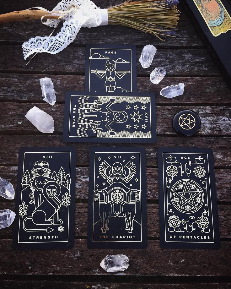 A black and gold foil tarot deck. Printed on black plastic and independently published. Comes with companion tarot apps for tarot readings tarot meanings and more on the go. For all lovers of magic witchcraft wicca paganism mysticism and more. Dark tarot deck unique tarot deck indie tarot deck.
