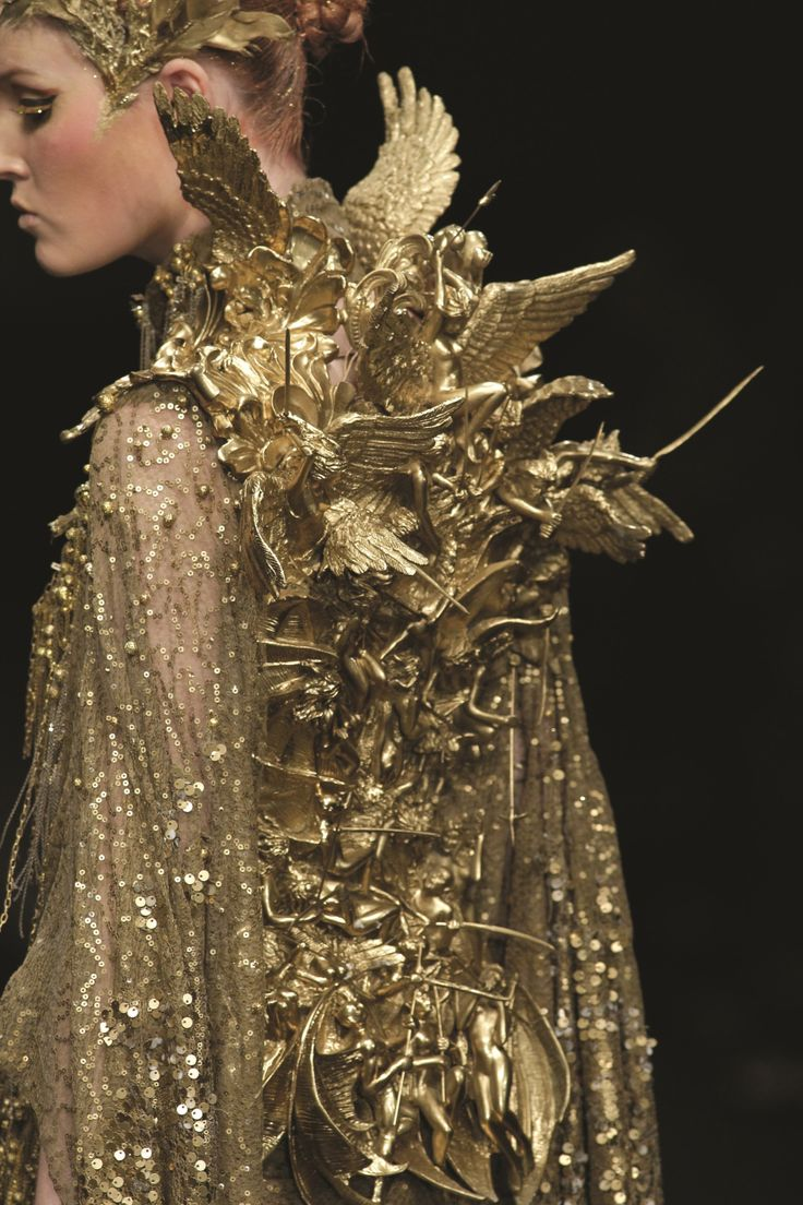 """baroqueporn: Tex Severio - Revelation Collection  Fashion Week 2012  Inspired by St. John the Divine's Book of Revelations this collection has an innately baroque style, with the use of hyperbolic figurines cast in metal and gold.   """"and there was war in Heaven"""" Rev. 12:7"""