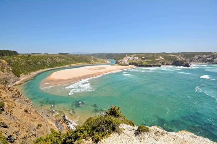 Praia de Odeceixe, Portugal – This is known as a haven for surfing guys and hippies during the summer, but there's definitely more to it than what meets the eye. It is a glorious beach that offers a stroll beside the river and is packed with houses on a few hills. That makes it a rather peaceful and relaxed place in Portugal. The fauna is superb, the weather even nicer and the ocean side glamorous. All in all, it's worth every dime.