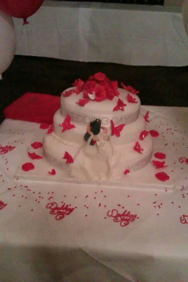 3 tier oval red roses and butterflies
