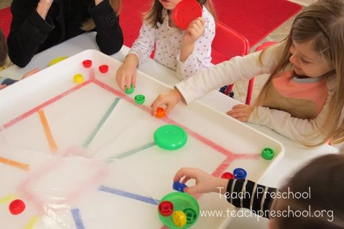 Ice Hockey Game- use plastic lids for pucks