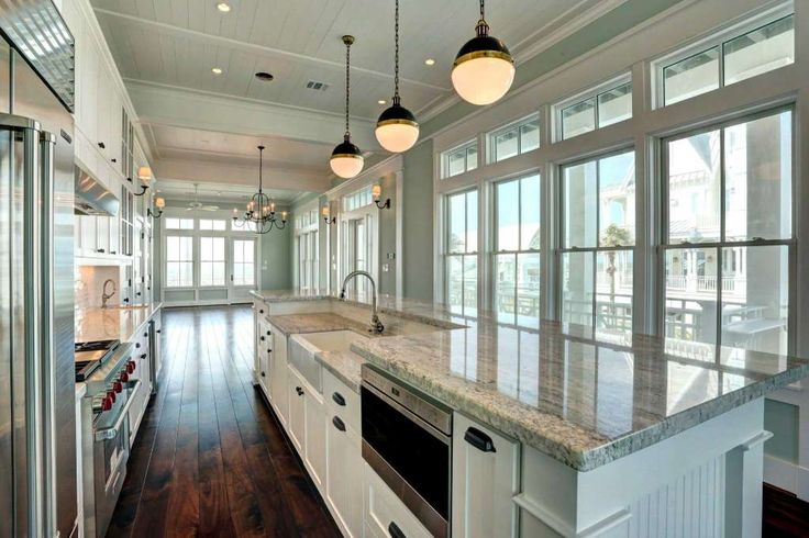 The second-floor great room in this Beachtown home in Galveston has a living room on the beach end, a dining area in the middle and a kitchen with a massive island on the street side. Photo: TK Images