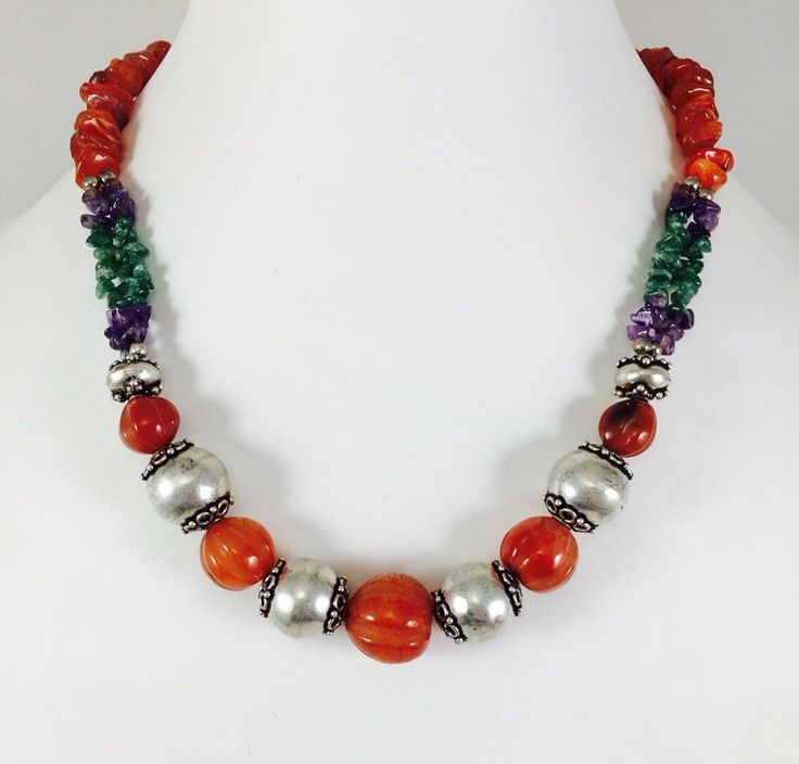 Hand made jewellery is made of semiprecious stones ( carnelian,amythist,agate) and silver plated beads. Price-40$