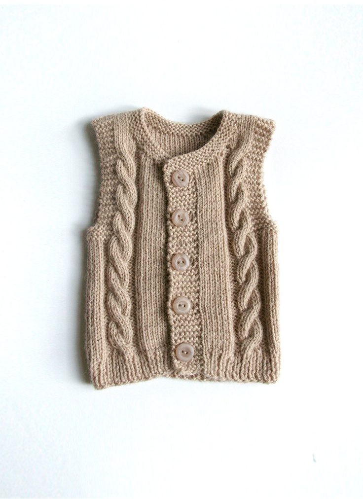 Knitted baby vest.