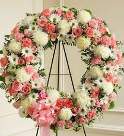 Serene Blessings Pink & White Standing Wreath Finding the perfect expression of your care and concern during difficult times requires thoughtful consideration. This standing wreath, crafted from exqui