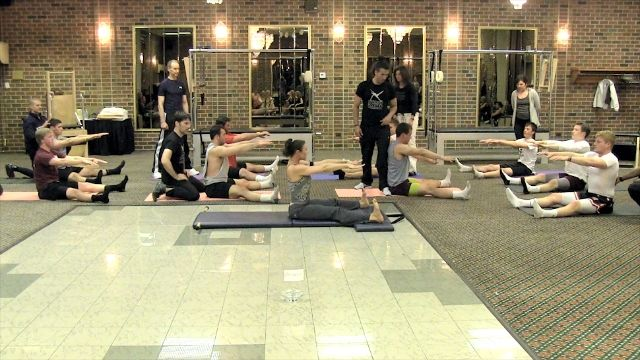 Kathy Ross Nash leads Chicago Football Team through Pilates Workout | pilatesology