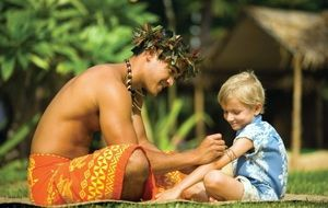 Best Oahu Family Activities: Temporary Tattoos Applied in the Arts and Crafts Area of the Paradise Cove Luau