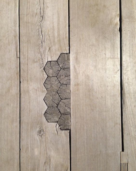 Broken is Beautiful: The Japanese Tradition That Makes Broken Things Even Better than Brand New - hexagonal piece of wood on a missing floorboard.