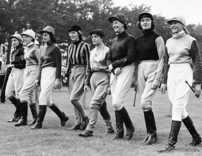 Eight women jockeys head for the stables to mount their horses at the Newmarket Heath track in Cambridgeshire, England, Oct. 14, 1957. They competed in the all-woman race, the Newmarket Town Plate. It was a four-mile event. From left to right are: J. Hylton; Miss Covell; Diana, Dutchess of Newcastle; N. Stephenson; Jill Wombwell; E. Cowell; Mrs. Nicholson and Scarlet Rimell.