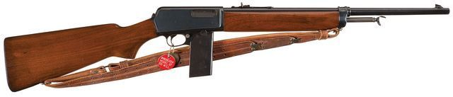"Winchester Model 1907 semi automatic rifle with extrended ""police style"" magazine."