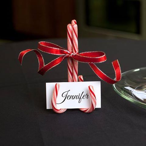The only supplies you need to make these festive candy cane name holders are candy canes (in color of your choice), a hot glue gun, some pretty ribbon and name cards with your guests names printed on them. Glue three candy canes upside down to create an easel and place your name card to be displayed.